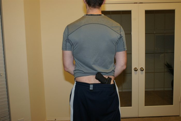 IWB Crossbreed Supertuck style Holster Concealing Glock 17 back view with Shirt Up