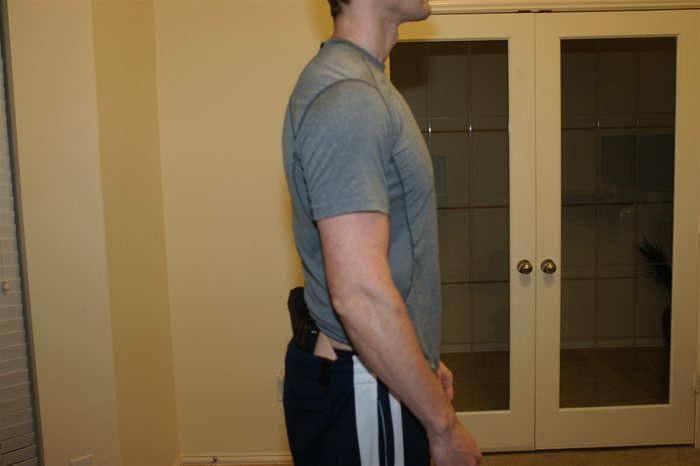 IWB Crossbreed Supertuck style Holster Concealing Glock 17 side view with Shirt Up